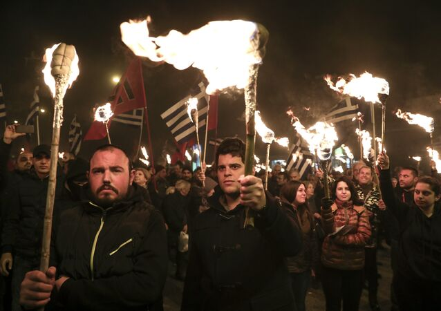 Supporters of Greece's extreme right Golden Dawn party raise torches during a rally commemorating a 1996 military incident which cost the lives of three Greek navy officers and brought Greece and Turkey to the brink of war, in Athens, on Saturday, Feb. 3, 2018