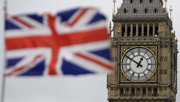 a British flag is blown by the wind near to Big Ben's clock tower in front of the UK Houses of Parliament in central London - Sputnik International