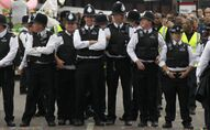 British police officers stand on duty during Europe's largest street festival, the Notting Hill Carnival in London, UK