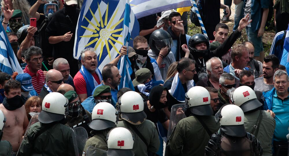Protesters argue with riot police during a demonstration against the agreement reached by Greece and Macedonia to resolve a dispute over the former Yugoslav republic's name, in Pisoderi village, northern Greece, June 17, 2018.