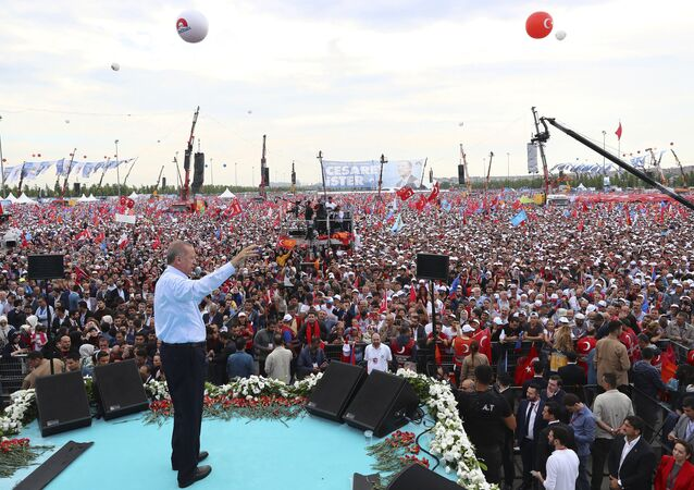 Turkey's President Recep Tayyip Erdogan, addresses supporters of his ruling Justice and Development Party (AKP) during a rally in Istanbul, Sunday, June 17, 2018