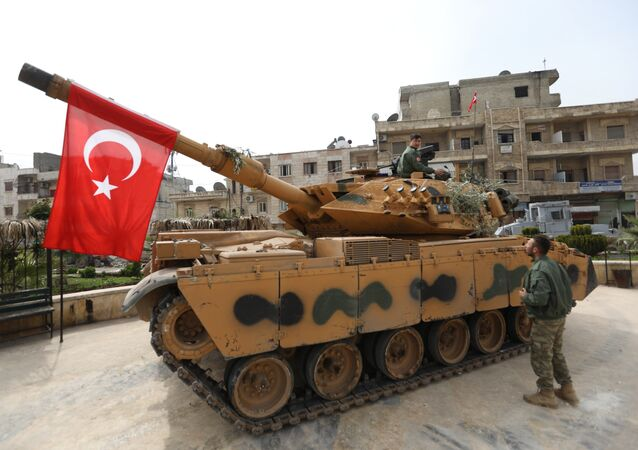 A tank belonging to Turkish soldiers and Ankara-backed Syrian Arab fighters is seen in the Kurdish-majority city of Afrin in northwestern Syria after they took control of it from Kurdish People's Protection Units (YPG) on March 18, 2018