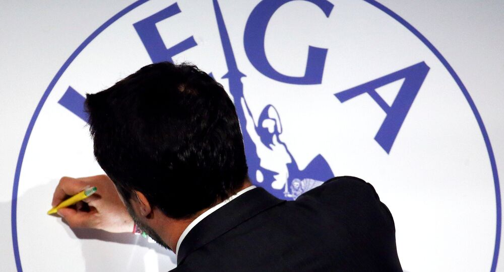 League leader Matteo Salvini signs the party symbol during a meeting in Rome, Italy, March 1, 2018