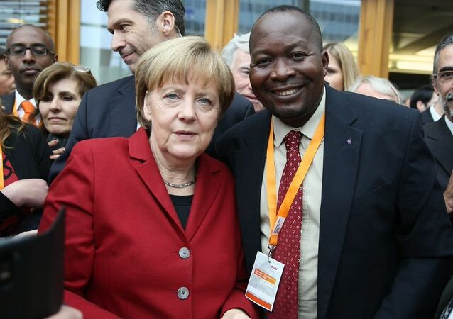 Robert Atangana with Angela Merkel