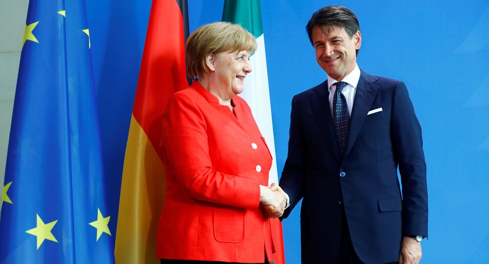 German Chancellor Angela Merkel and Italian Prime Minister Giuseppe Conte shake hands after a news conference at the chancellery in Berlin, Germany, June 18, 2018