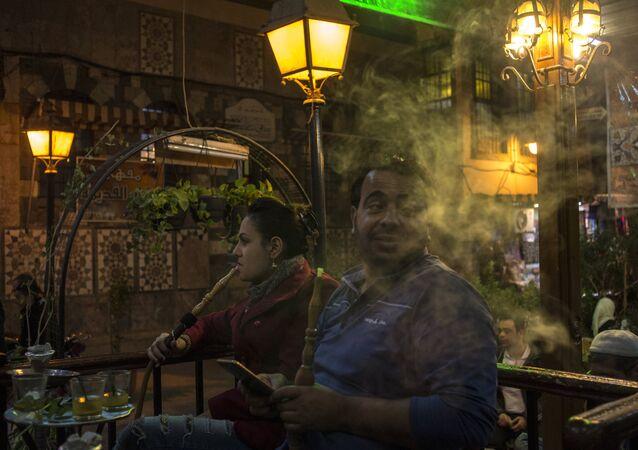 People smoke hookah