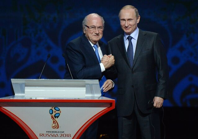 July 25, 2015. Russian President Vladimir Putin (right) and FIFA President Sepp Blatter during the FIFA 2018 World Cup Preliminary Draw (File)