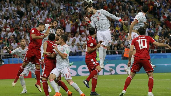 Spain's Gerard Pique, center, jumps for a header during the group B match between Iran and Spain at the 2018 soccer World Cup in the Kazan Arena in Kazan, Russia, Wednesday, June 20, 2018. - Sputnik International
