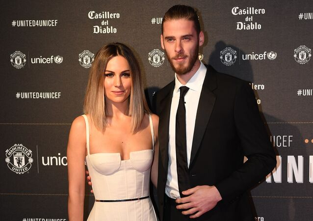 Manchester United's Spanish goalkeeper David de Gea (R) and Edurne Garcia pose on the red carpet as they arrive to attend the United for UNICEF Gala Dinner at Old Trafford in Manchester, north-west England, on November 15, 2017