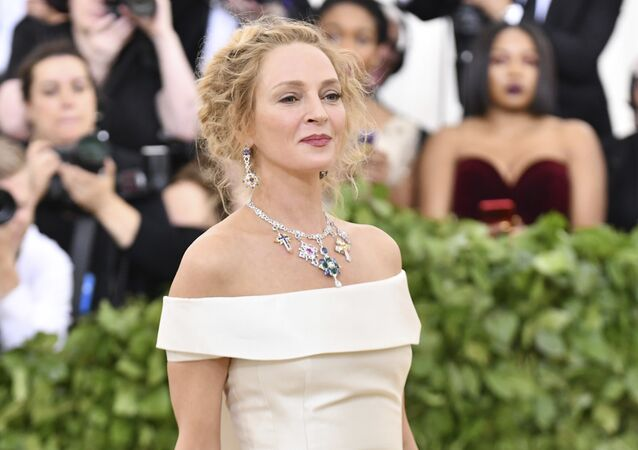 Uma Thurman attends The Metropolitan Museum of Art's Costume Institute benefit gala celebrating the opening of the Heavenly Bodies: Fashion and the Catholic Imagination exhibition on Monday, May 7, 2018, in New York