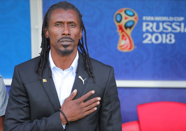 Senegal's head coach Aliou Cisse listens to the national anthem before the World Cup Group H soccer match between Poland and Senegal at the Spartak stadium in Moscow, Russia, June 19, 2018