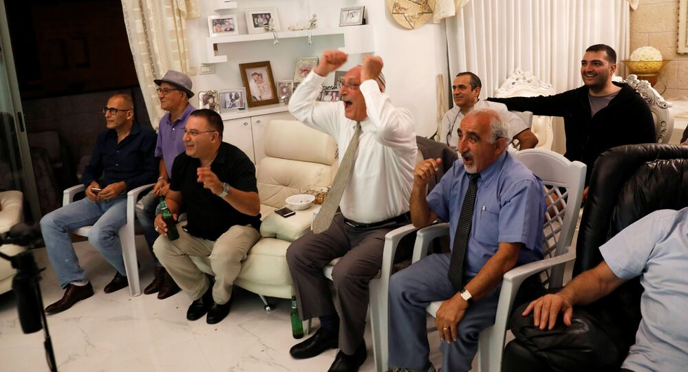 Israelis of Iranian origin cheer for Iran as they watch the Iran-Spain World Cup match in the living room of the Hasid family in Jerusalem, June 20, 2018