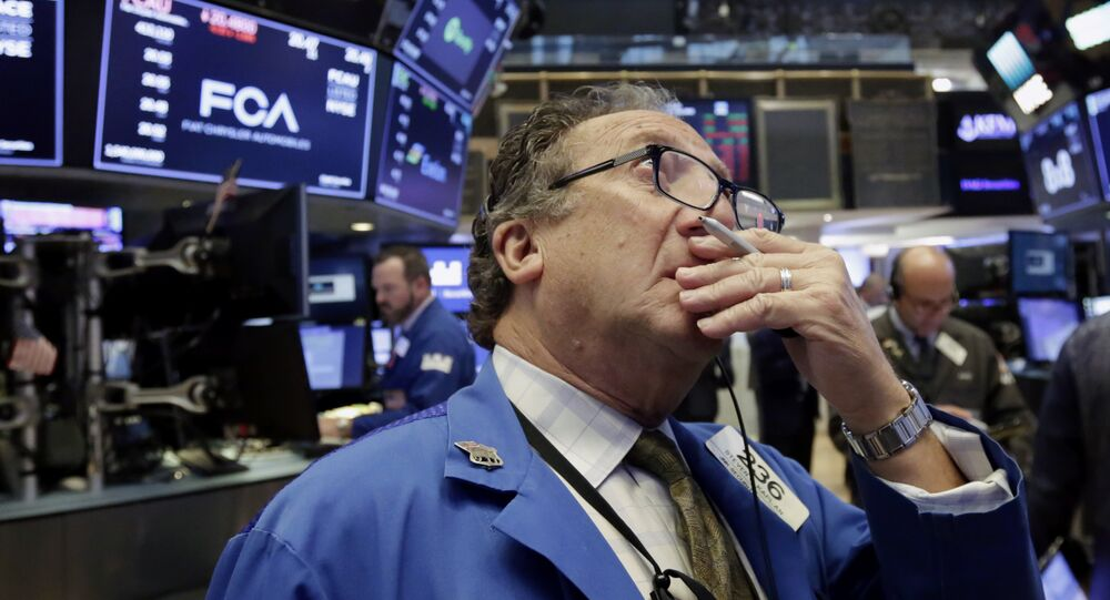 Trader Steven Kaplan works on the floor of the New York Stock Exchange, Tuesday, June 19, 2018. U.S. stock markets are opening sharply lower Tuesday as tensions over trade between the U.S. and China seem closer to a boil