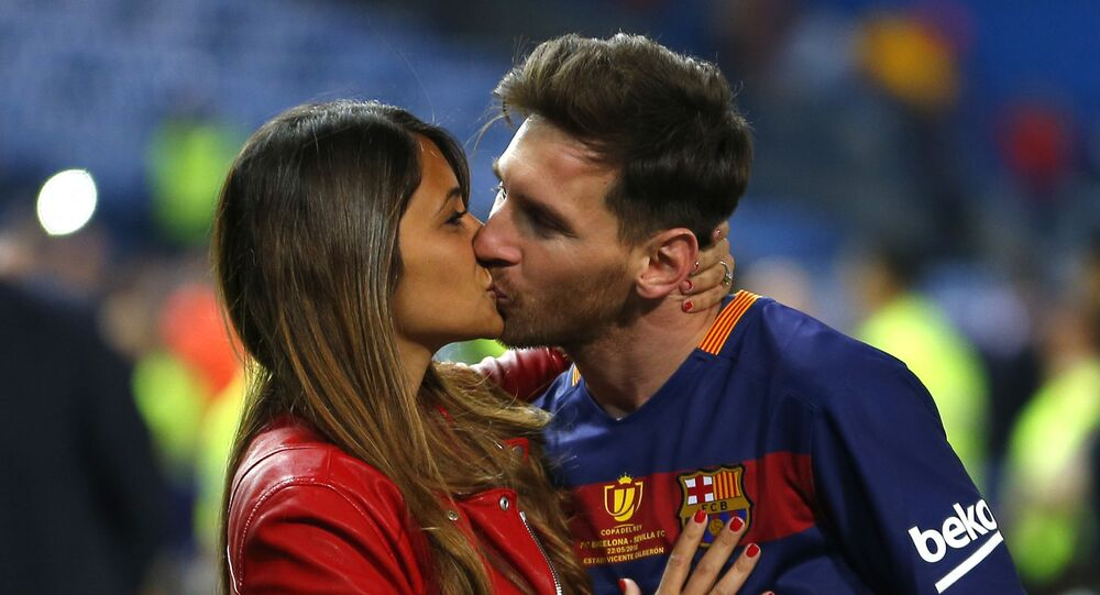 In this Sunday, May 22, 2016 file photo, Barcelona's Lionel Messi kisses his wife Antonella Roccuzzo as they celebrate after winning the final of the Copa del Rey soccer match between FC Barcelona and Sevilla FC at the Vicente Calderon stadium in Madrid
