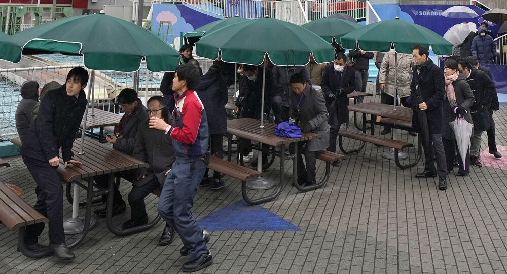 (File) Participants are guided during an evacuation drill simulating a North Korea ballistic missile attack in Tokyo, Monday, Jan. 22, 2018