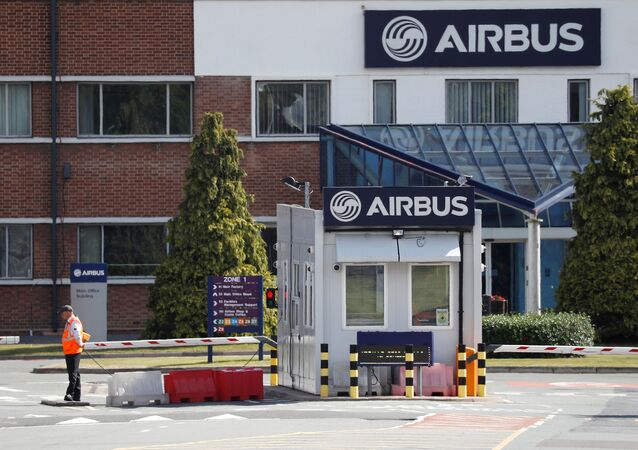 A security guard stands at the entrance to Airbus' wing assembly plant at Broughton, near Chester, Britain, June 22, 2018