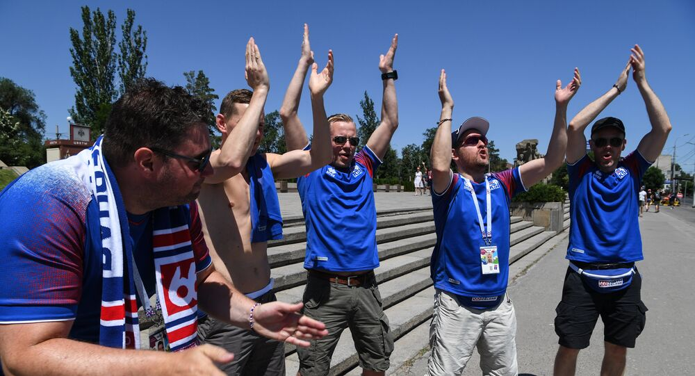 Supporters of Iceland's national football team clap while visiting visit the Mamayev Kurgan World War Two memorial complex in Volgograd on June 22, 2018, hours before the Russia 2018 World Cup Group D football match between Nigeria and Iceland
