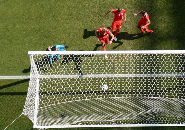Belgium's goalkeeper Thibaut Courtois misses a goal during the World Cup Group G soccer match between Belgium and Tunisia at the Spartak stadium, in Moscow, Russia, June 23, 2018