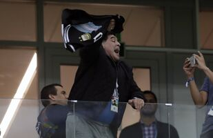 Argentina's former soccer star Diego Maradona cheers for his team before the group D match between Argentina and Croatia at the 2018 soccer World Cup in Nizhny Novgorod Stadium in Nizhny Novgorod, Russia, Thursday, June 21, 2018