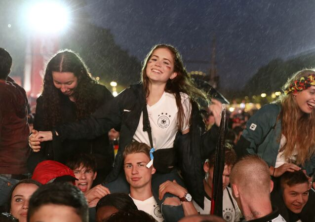 World Cup - Group F - Germany vs Sweden - Berlin, Germany - June 23, 2018 Germany soccer fans react after the match at a public viewing area at Brandenburg Gate.