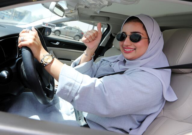 Zuhoor Assiri drives her car in Dhahran, Saudi Arabia, June 24, 2018