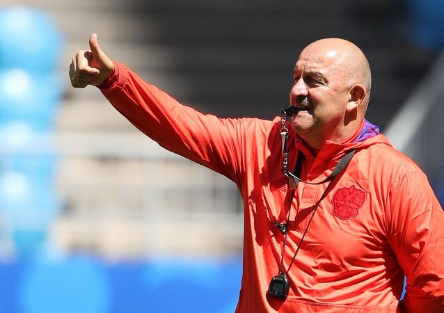 Russia's head coach Stanislav Cherchesov gestures to players during the national soccer team's training session in Samara, Russia, June 24, 2018