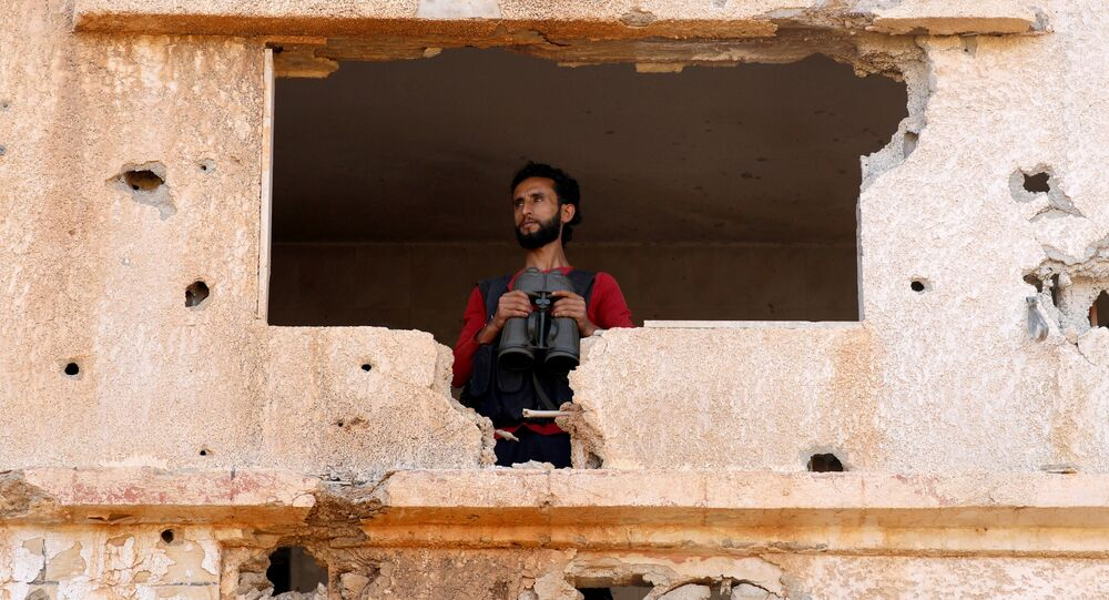 A fighter from the Free Syrian Army is seen in Yadouda area in Deraa, Syria May 29, 2018