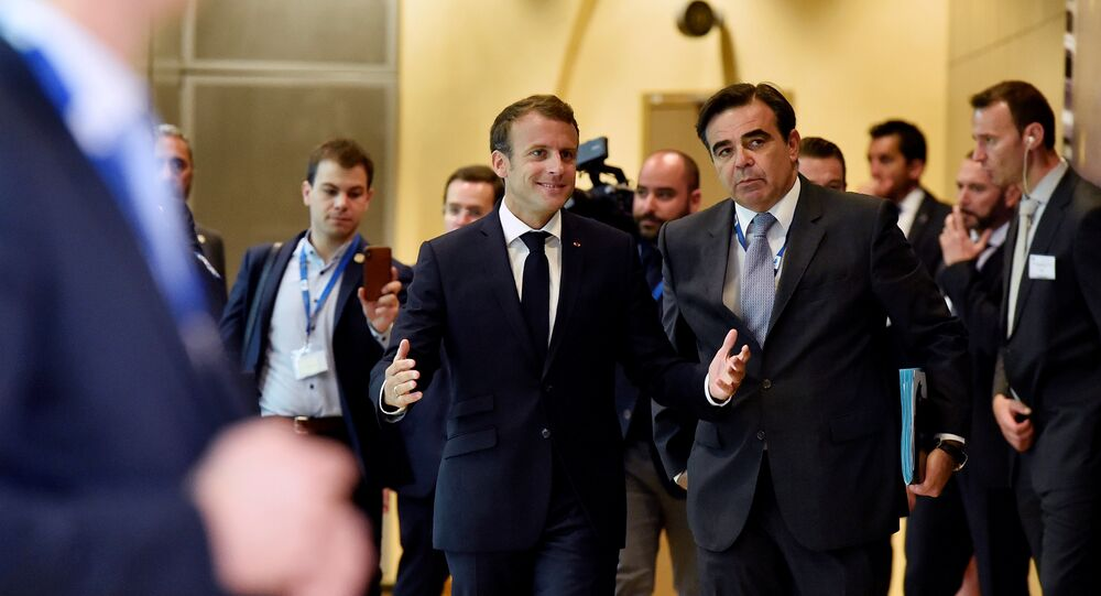 French President Emmanuel Macron arrives to take part in an emergency European Union leaders summit on immigration, in Brussels, Belgium June 24, 2018