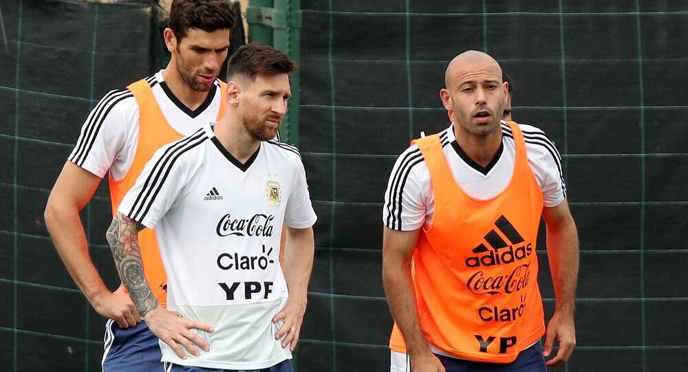 Soccer Football - FIFA World Cup - Argentina Training - Ciutat Esportiva Joan Gamper, Barcelona, Spain - June 2, 2018 Argentina's Lionel Messi and Javier Mascherano during training