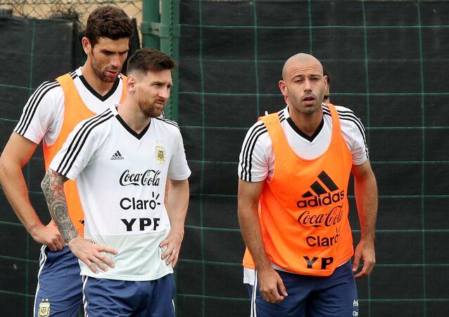 Soccer Football - FIFA World Cup - Argentina Training - Ciutat Esportiva Joan Gamper, Barcelona, Spain - June 2, 2018 Argentina's Lionel Messi and Javier Mascherano during training