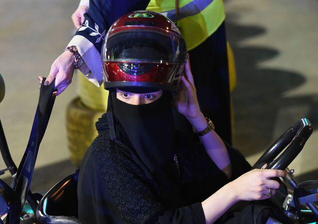 Saudi woman prepares to use go-kart in Riyadh