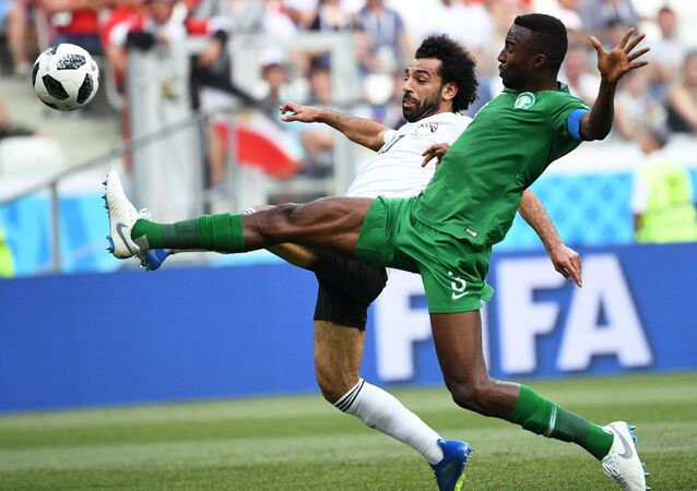 Soccer Football - World Cup - Group A - Saudi Arabia vs Egypt - Volgograd Arena, Volgograd, Russia - June 25, 2018 Egypt's Mohamed Salah in action with Saudi Arabia's Osama Hawsawi