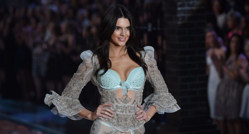Model Kendall Jenner presents a creation during the 2015 Victoria's Secret Fashion Show in New York on November 10, 2015