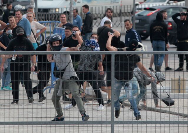 Protesters throw stones during clashes with riot police in a protest against the agreement reached by Greece and Macedonia to resolve a dispute over the former Yugoslav republic's name, in Thessaloniki, Greece, June 25, 2018