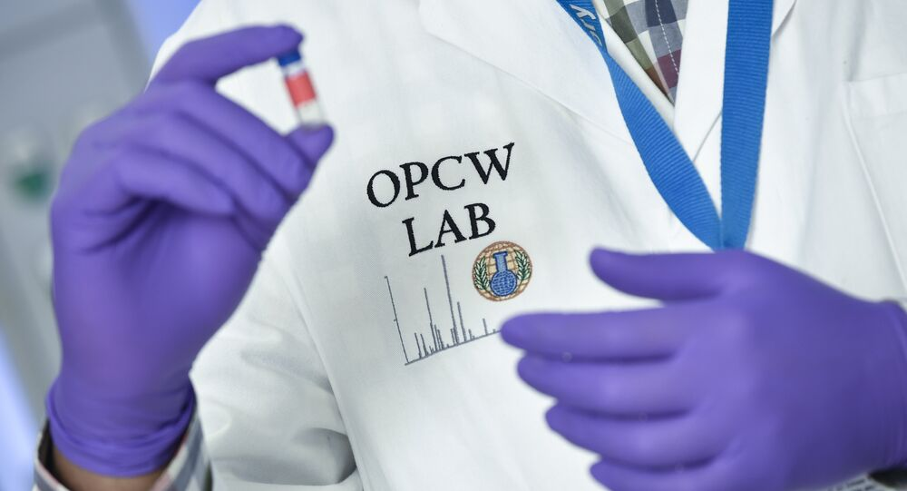(FILES) In this file photo taken on April 20, 2018 a laboratory technician controls a test vial at the OPCW (The Organisation for the Prohibition of Chemical Weapons) headquarters in the Hague, The Netherlands, on April 20, 2017