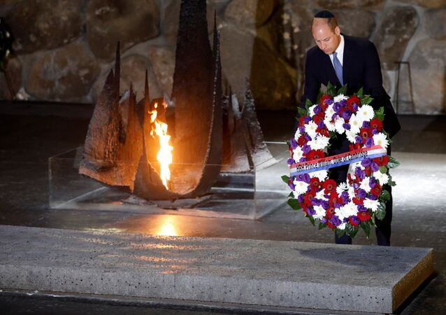 Britain's Prince William lays a wreath during a ceremony commemorating the six million Jews killed by the Nazis in the Holocaust, in the Hall of Remembrance at Yad Vashem World Holocaust Remembrance Center in Jerusalem, June 26, 2018
