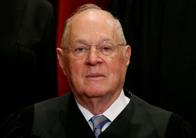 FILE: PHOTO: U.S. Associate Supreme Court Justice Anthony Kennedy participates in taking a new family photo with fellow justices at the Supreme Court building in Washington, U.S., June 1, 2017.