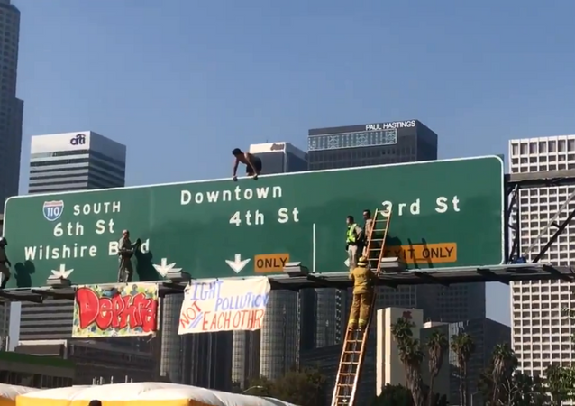 California man shuts down southbound lanes of Los Angeles' 110 Freeway after climbing on top of traffic signs