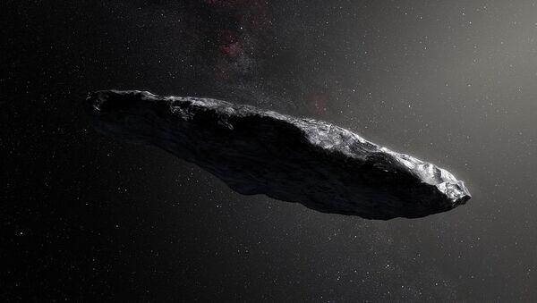 This artist's impression shows the first interstellar asteroid, `Oumuamua - Sputnik International