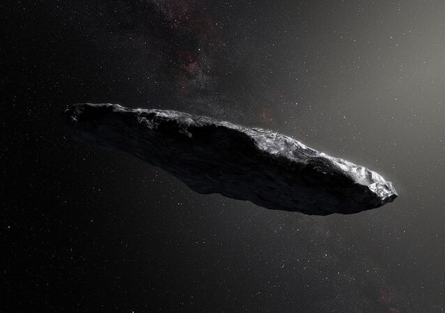 This artist's impression shows the first interstellar asteroid, `Oumuamua