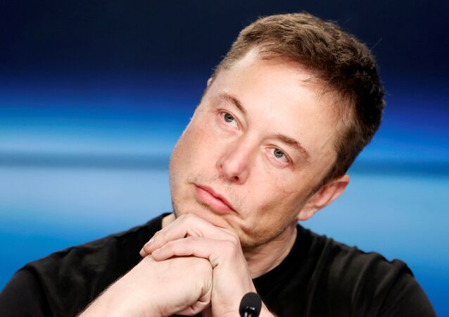 FILE PHOTO: Elon Musk listens at a press conference following the first launch of a SpaceX Falcon Heavy rocket at the Kennedy Space Center in Cape Canaveral, Florida, U.S., February 6, 2018