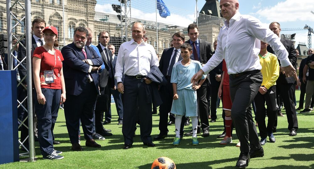 June 28, 2018. Russian President Vladimir Putin and FIFA president Gianni Infantino, right, visit the themed 2018 FIFA World Cup Football Park on Red Square