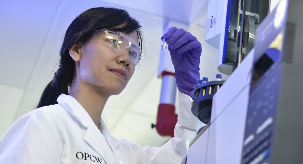 A laboratory technician controls a test vial at the OPCW (The Organisation for the Prohibition of Chemical Weapons) headquarters in the Hague, The Netherlands, on April 20, 2017
