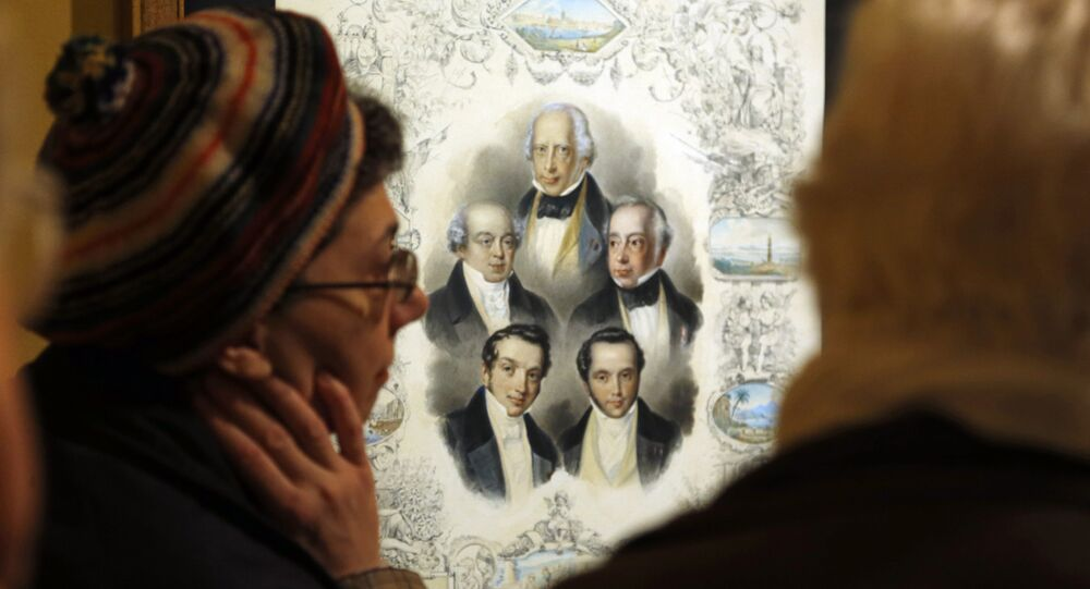 People look at a painting displayed as part of the exhibition The Rothschilds in France in the 19th century on November 19, 2012 at the Bibliotheque nationale de France (BnF) in Paris