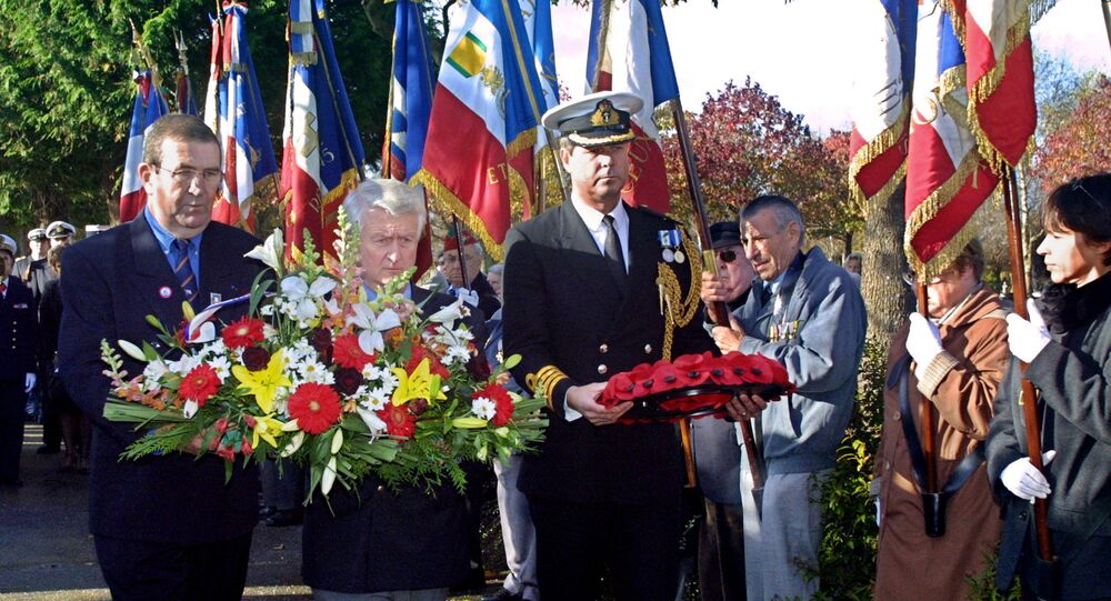 British naval attache Nicholas Butler (right) laying a wreath at the Mers-el-Kebir memorial in Brest in 2005