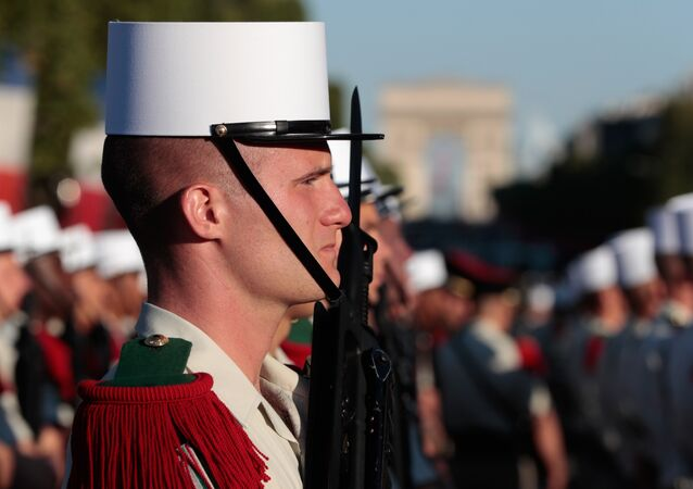 Troops of the 3e regiment etranger d'infanterie (3rd Foreign Infantry Regiment) prepare to take part in the annual Bastille Day military parade on the Champs-Elysees avenue in Paris on July 14, 2017