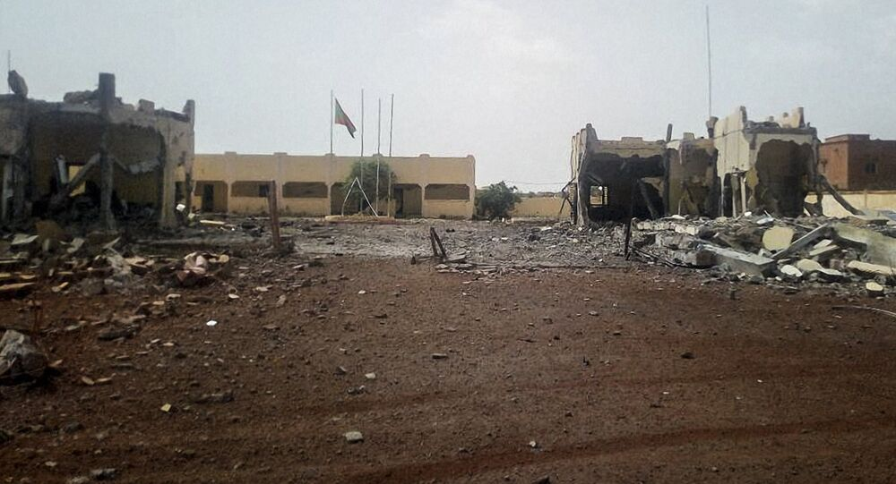 A picture taken in Sevare in central Mali, on June 29, 2018 shows debris scattered in front of the head quarter of the anti-terror task force, the G5 Sahel, after an attack of a suicide bomber who tried to penetrate the base