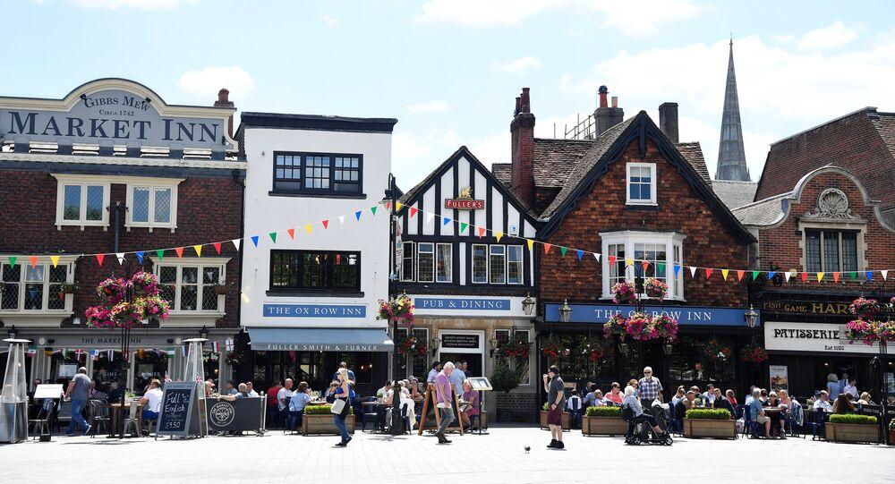 People walk along the high street in Salisbury, Britain, June 22, 2018