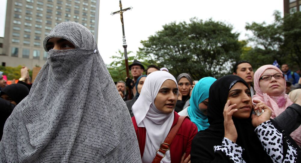 Women in traditional garb gather to protest against Quebec's proposed Charter of Values in Montreal, Quebec, Canada, September 14, 2013