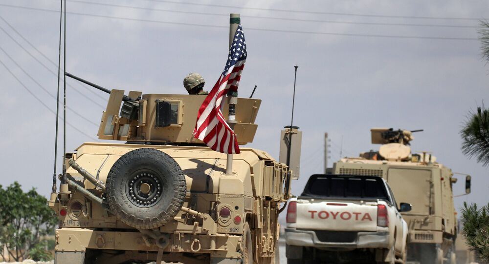 The U.S. flag flutters on a military vehicle in Manbij countryside, Syria May 12, 2018